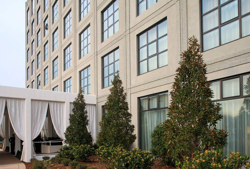 Proximity hotel multifamily residential, high performance insulated wall panel on exterior