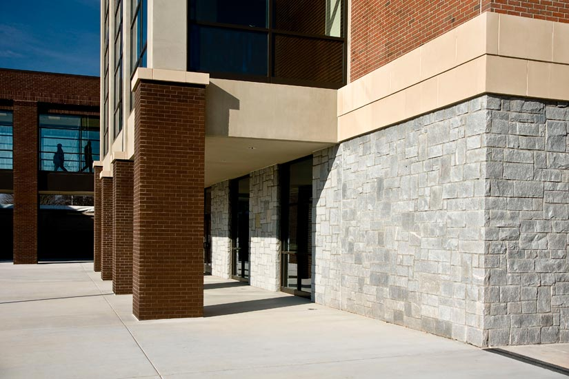 Tucker high school education, detail on precast granite panel on exterior