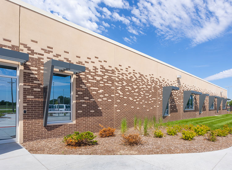 DC West Elementary School exterior showing windows and brick pattern