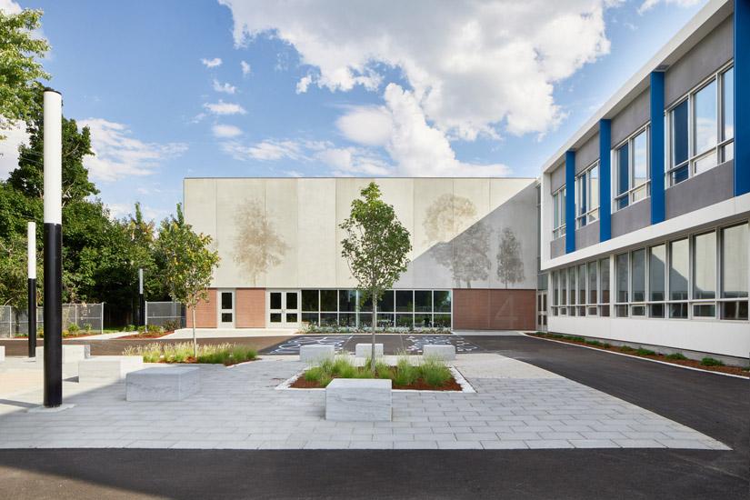 Ecole Cure Paquin exterior showing Graphic Concrete tree pattern panels