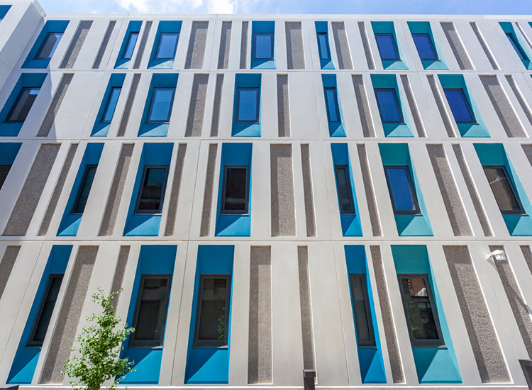 Kansas City Art Institute Student Housing exterior detail with blue panels