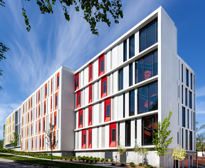 Kansas City Art Institute Student Housing exterior corner view with warm color panels